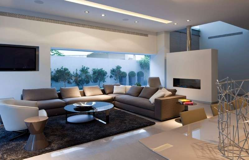 Un salotto dal design pulito e accattivante accademia for Foto di arredamenti moderni